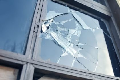 using crime stats to determine the safety of a town; broken window indicating crime in the area